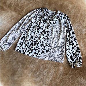 Cabi #590 animal print wrap blouse. Snap closure